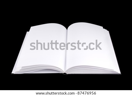 An open book with empty pages isolated on black - stock photo