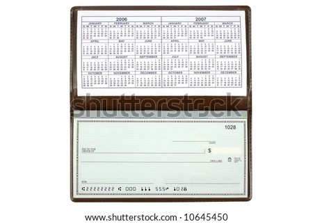 An open checkbook showing the calendar.