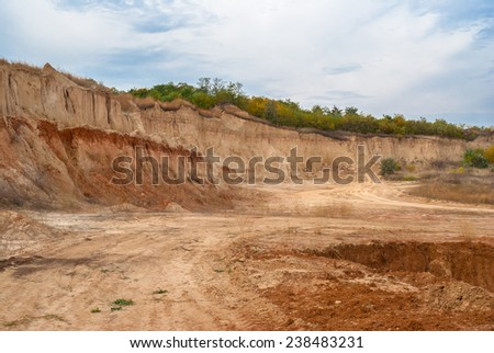 An open clay pit in central Ukraine - stock photo