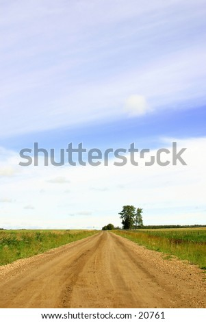 An open country road on the praries. - stock photo