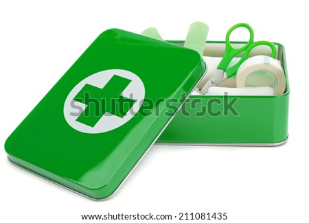 An open first aid kit with contents on a white background - stock photo