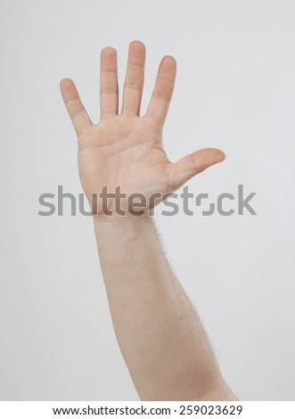an open hand is stretched in the air - stock photo