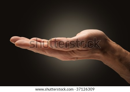 An open hand on brown background - stock photo
