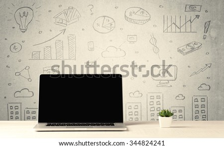 An open laptop on a white office desk with flower, coffee, books in front of wall background full of financial business charts concept - stock photo