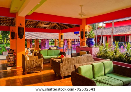 An open lobby interior of a hotel with sofa, armchairs and coffee table - stock photo