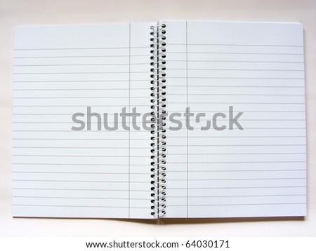An open note pad with spiral bind