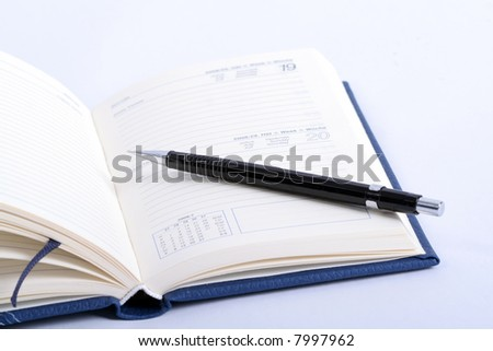 an open notebook with pencil