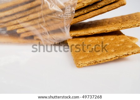 an open package of graham crackers isolated on light background with copy space below - stock photo