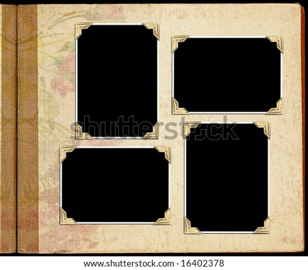 An open photo album with plank places for photos - stock photo