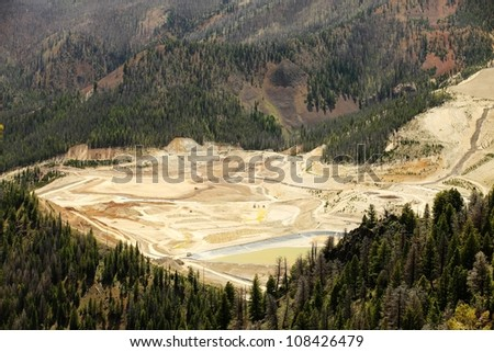 An open pit gold mine that also produces copper, silver, and molybdenum - stock photo