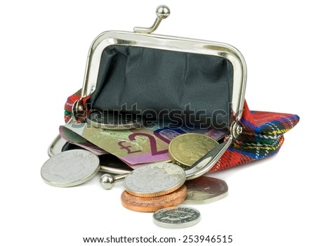 An open purse with British currency on a white background - stock photo