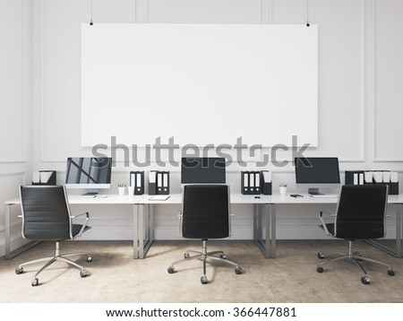 An open space office, tables with computers arranged along the wall, workers facing each other. Big board on the wall. Concept of work. 3D rendering - stock photo