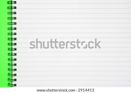 An open spiral notepad with blank lined paper. - stock photo
