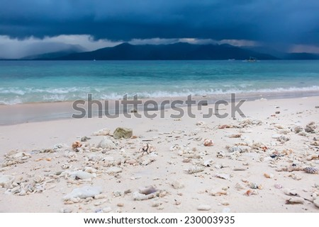 An open tropical island beach with sky and clouds. Gili Meno, Indonesia. - stock photo