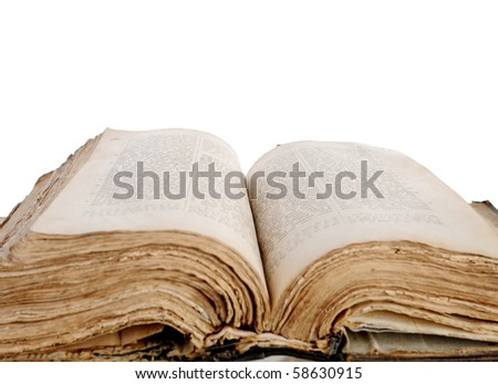 An opened Bible. Focus on the text. Isolated on white background - stock photo
