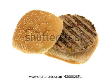 An opened faced veggie burger in a bun isolated on a white background.  - stock photo