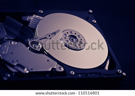 an opened hard disk on black background