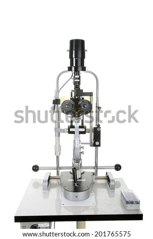 An Ophthalmologist Slit Lamp, isolated on white with room for your text. Slip Lamps are used by Ophthalmologist and Optometrist, and Eye Care Professionals to view into your eyes with a microscope.  - stock photo