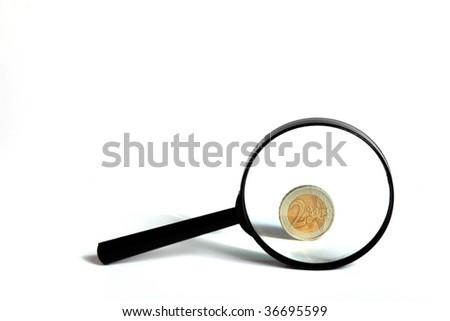 an optical lens and  2 euro - stock photo
