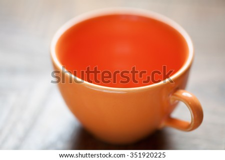 An orange coffee cup - stock photo