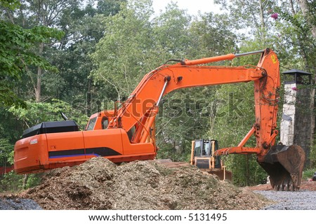 An Orange Front End Loader on a residential construction site - stock photo