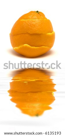 An orange peal being healed.  (with water reflection) - stock photo