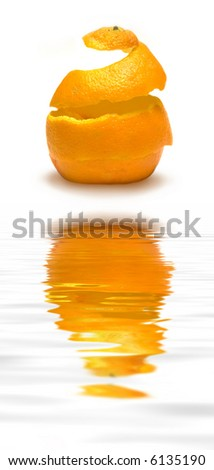 An orange peel being reconstructed!  (with water reflection) - stock photo
