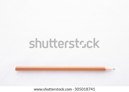 An orange pencil isolated on white background