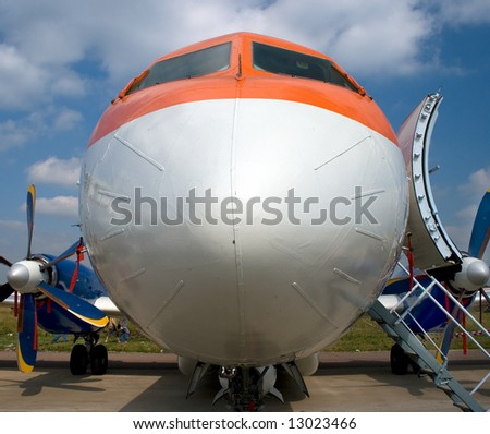 An orange plane view from the front