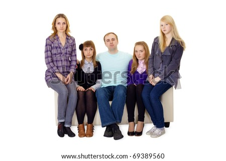 An ordinary family with many children sitting on the couch - stock photo