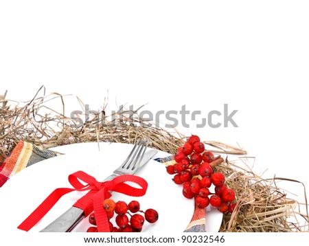 An orginal christmas place setting with white plates , hay and christmas ornaments - stock photo