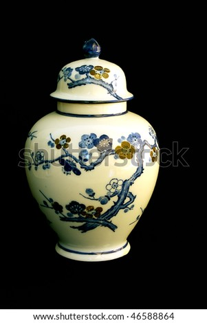 An oriental vase decorated with tree blossom flowers - stock photo