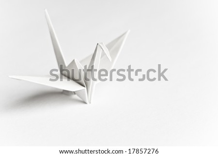 An origami bird on a white background - stock photo