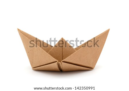 An origami boat on white - stock photo