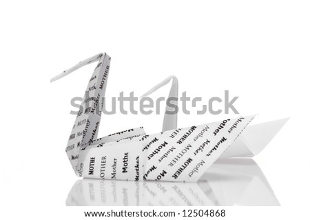 An origami mother swan and its cygnet on a high-key background. - stock photo