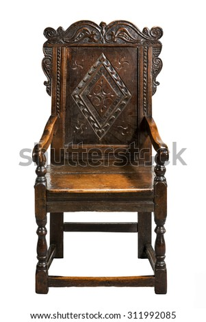 An original seventeenth century wainscot chair carved made of oak isolated on white with clipping path.