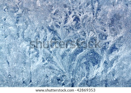 An ornament of frost on a window - stock photo