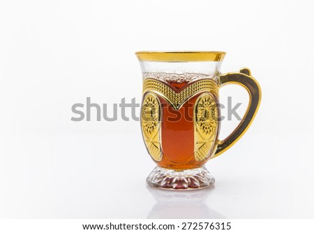 An ornamental cup of sulemani tea - an arabic black tea. - stock photo