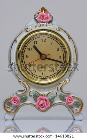 An Ornate Antique Clock - stock photo