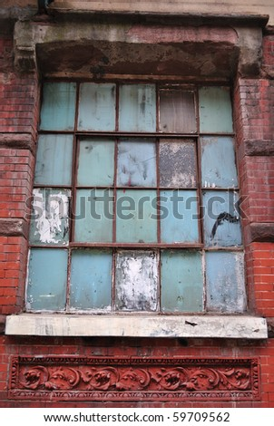 An ornate but unmaintained building facade. - stock photo
