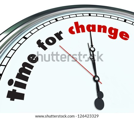 An ornate clock with the words Time for Change on its face