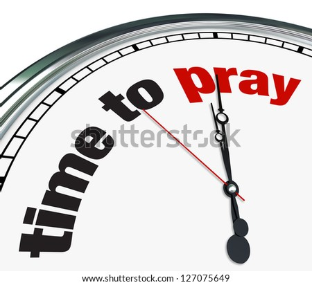 An ornate clock with the words Time to Pray on its face - stock photo