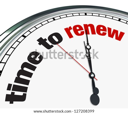 An ornate clock with the words Time to Renew on its face - stock photo