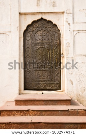 An ornate decorated door inside the Red Fort of Old Delhi in India