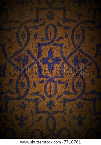 An ornate design on grungy wood. - stock photo