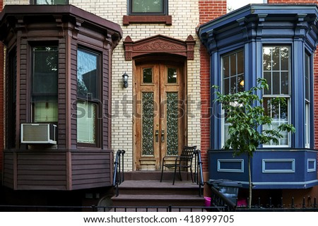 an ornate door on a big city building - stock photo