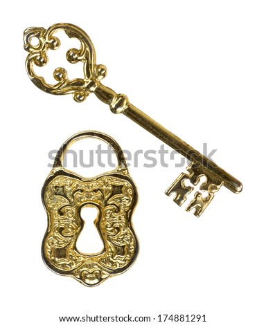 An ornate skeleton key and a lock face on a white background. - stock photo