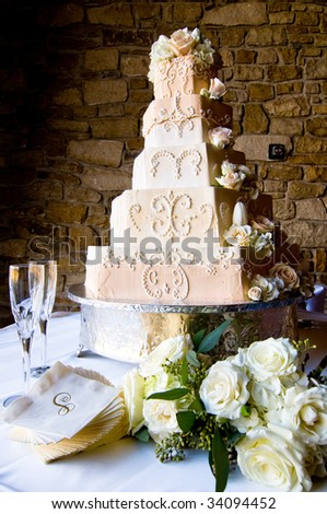 an ornately decorated wedding cake - stock photo