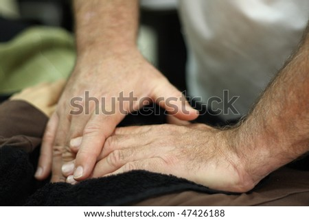 An osteopath is treating a patient