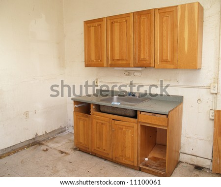 an outdated kitchen in need of repair and remodeling - stock photo